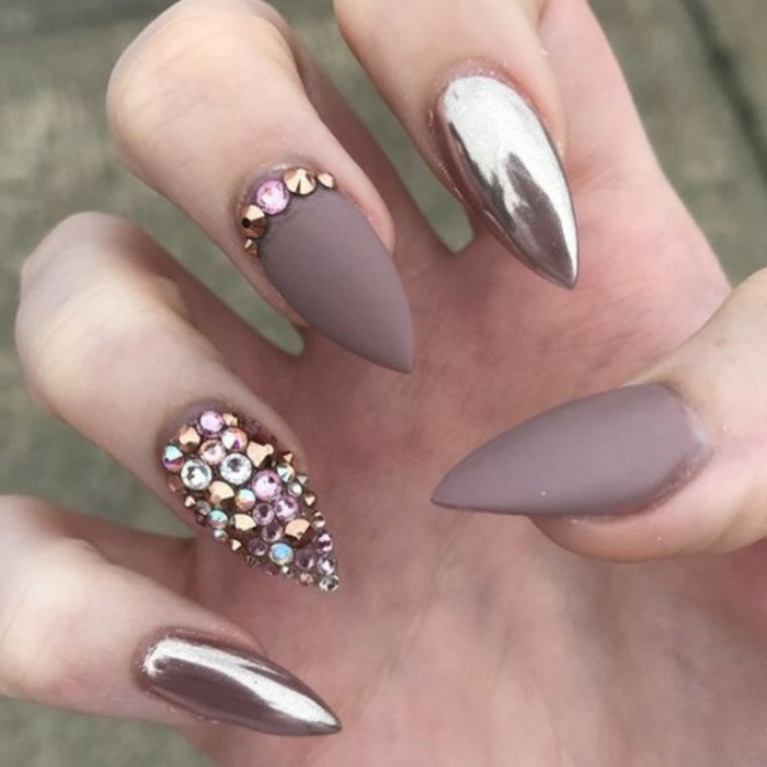 understated and chic manicure, matte beige nail polish, and rose gold metallic effect, pink and pale blue rhinestone stickers