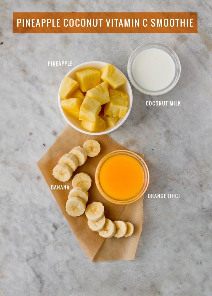 ingredients needed for making a smoothie, easy smoothie recipes, coconut milk in small bowl, pineapple and banana chunks, and orange juice
