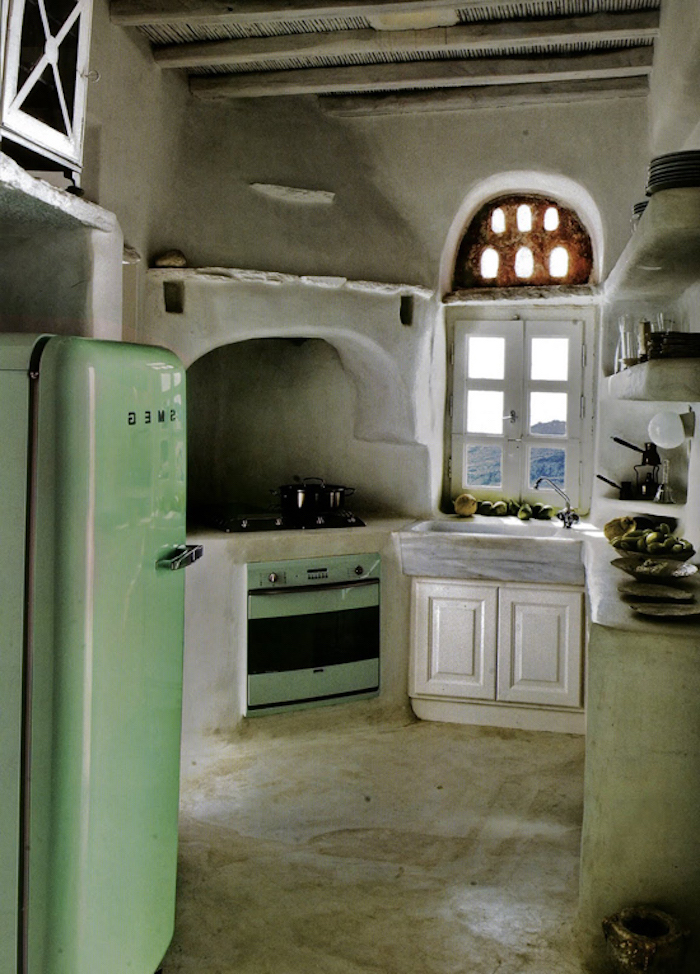 country kitchen decorating ideas, peasant style home, with modern pale green stove, and matching fridge, asymmetrical walls and rounded corners