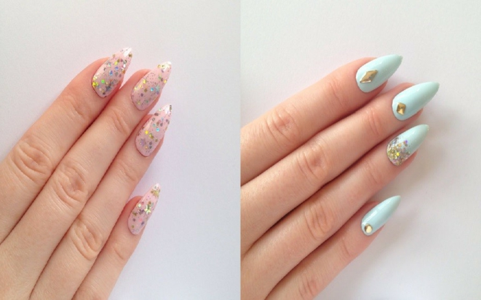 multicolored glitter and rhinestone stickers, on stiletto acrylic nails, painted in pale pink, and baby blue nail polish,