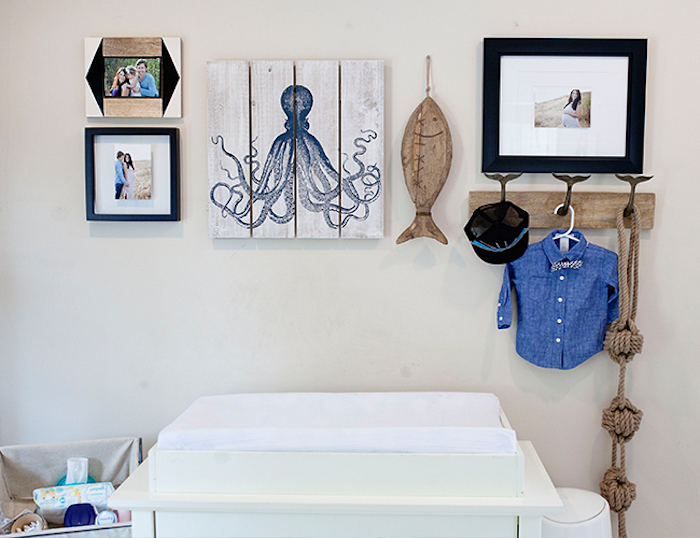 sailor themed boys room ideas, octopus painting and wooden fish ornament, three framed family photos, knotted rope decorations