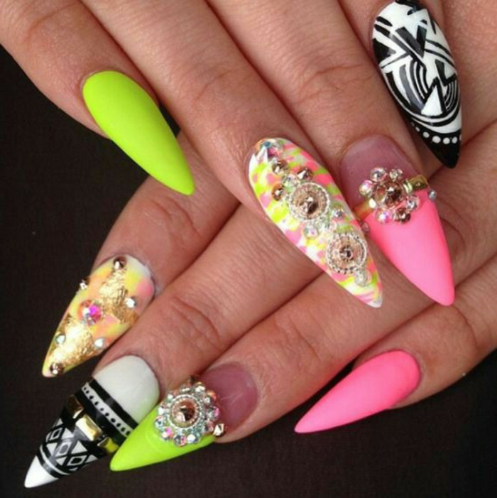 bright multicolored claw nails, kitsch mix of neon colors, bright acid green and pink, black and white, various rhinestone stickers