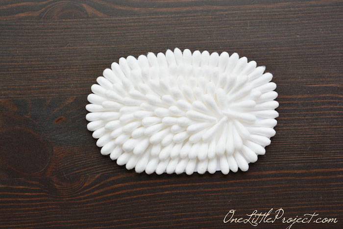 piece of paper, with oval form, entirely covered in white, cotton bud tips, craft ideas for kids, making the sheep's body