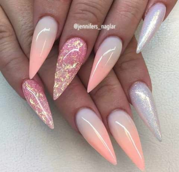 ombre-effect sharp and long, stiletto acrylic nails, in pale pastel blue and pink, decorated with silver and pink glitter