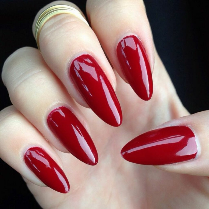 chic red manicure, glossy deep color, on oval long stiletto nails, perfect classic look