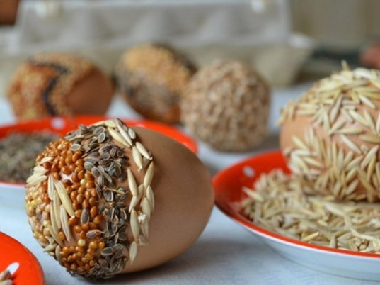seeds from different varieties, easter crafts for adults, chia and oats, millet and others, used to decorate easter eggs