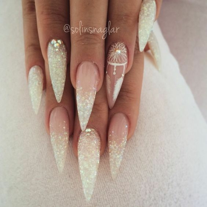 claw nails, with french style manicure, long and sharp, with pink bottom part, and white tips covered in glitter, rhinestones and little white, hand-drawn dream catcher detail