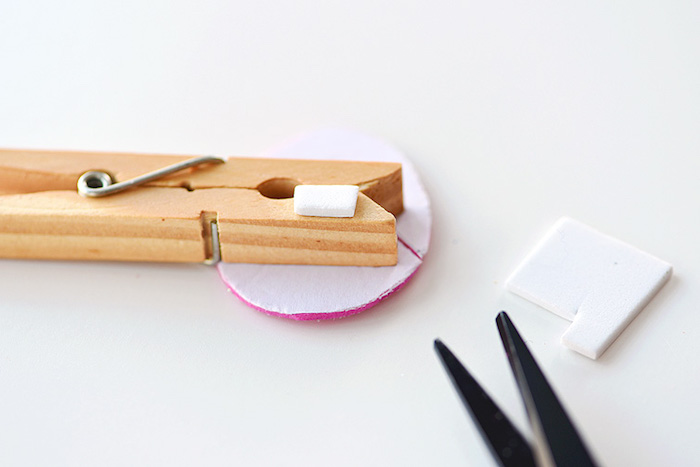 two-sided sticky tape, on wooden clothespin, stuck to egg-shape, made from thick card, easter projects, near black scissors