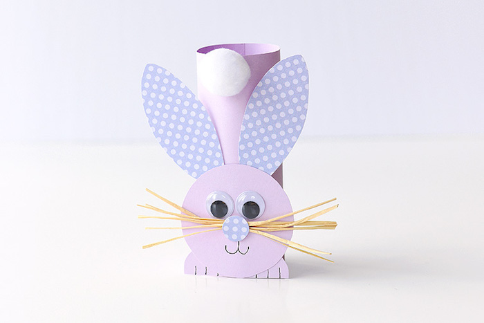 completed easter bunny decoration, easter diy, made from pale purple card, with spotted violet ears, white cotton ball tail, straw-like whiskers