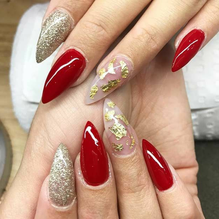 gold leaf and glitter, and smooth red nail polish, on sharp and long stiletto nails, chic and glamorous