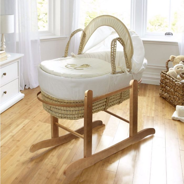 wicker baby basket, with rocking wooden feet, in pale beige, covered with white and ivory embroidered fabric, retro nursery ideas, light laminate floor