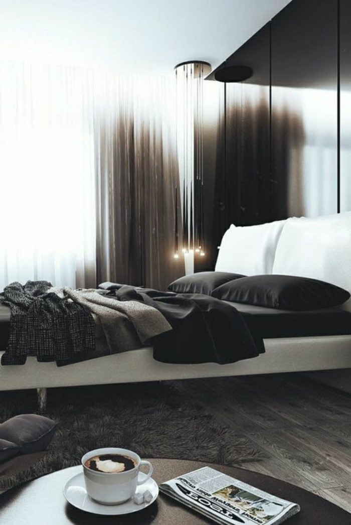 stylish bedroom in dark brown, gray and white, with fluffy rug, and dark grayish-brown wooden floor, round dark table