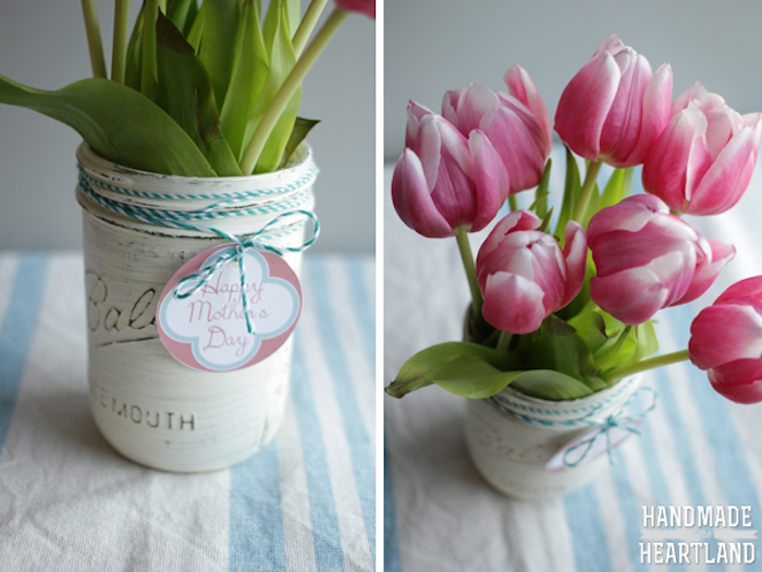 mason jar with white, hand-painted surface, label tied around with tread, mothers day presents, containing a bouquet, of pink and white tulips