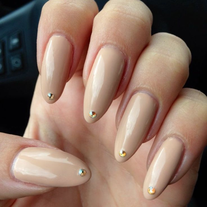 chic and very long, stiletto acrylic nails, with tiny and round, yellow rhinestone stickers