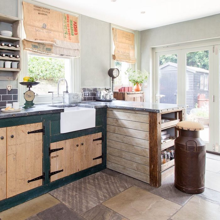 bright room with glass doors, pale gray walls, beige and dark green, vintage country kitchen cabinets, various rustic decorations