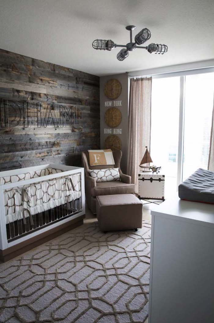 dark brown and gray wooden planks, on boy nursery wall, with wire letters spelling baby's name, beige and brown carpet