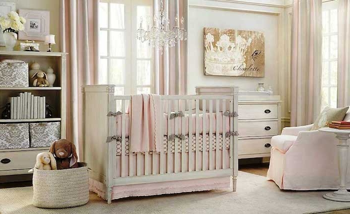 stuffed animal toys, in pale beige basket, near white crib, with pink bedding, girl nursery themes , spacious room with white walls, and pale pink curtains