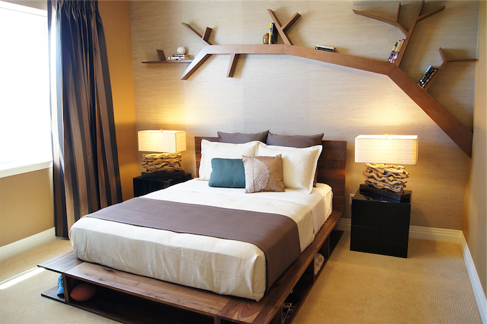 master bedroom ideas, large wooden shelf, shaped like a tree branch, mounted on a wall over a double bed, two matching nightstands, with identical lamps