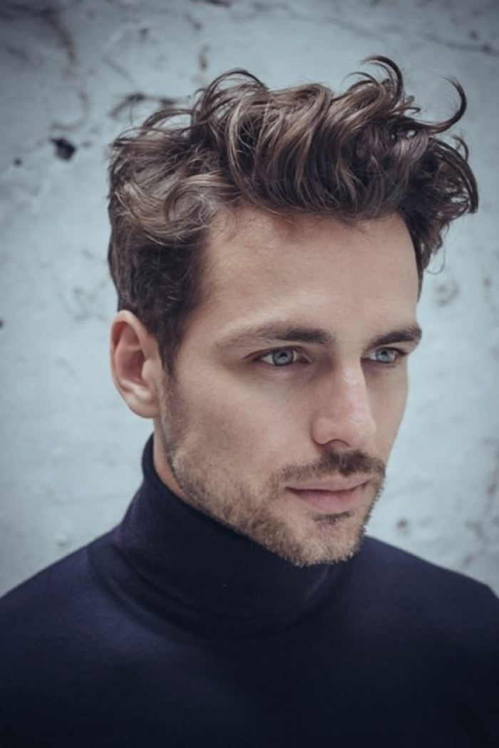 soft brunette curls, styled in a casual messy manner, curly hairstyles, on blue-eyed man, with short beard and mustache, wearing a black turtleneck