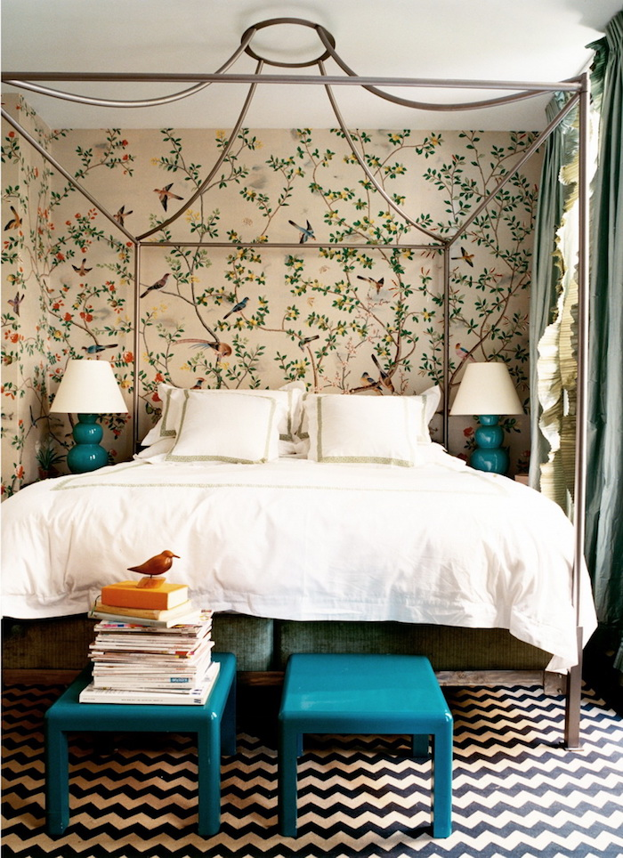 cream wallpaper with thin tree branches, small green leaves and various birds, near double bed, surrounded with wrought iron bars, master bedroom ideas, romantic antique style
