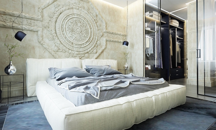 stone carving in ivory, near a soft white bed, bedroom wall decor, hanging lights and a walk-in wardrobe, with a glass door