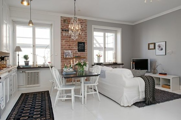 small apartment living room ideas, white floor and walls, in room with two windows, kitchen area and dining table with chairs, white sofa and TV