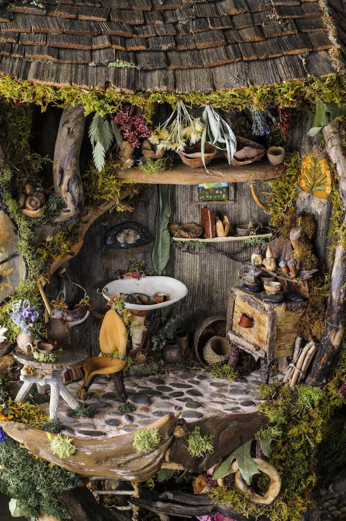 countryside style diy fairy house, with miniature shabby furniture, many tiny items, dried plants and flowers, moss and bark