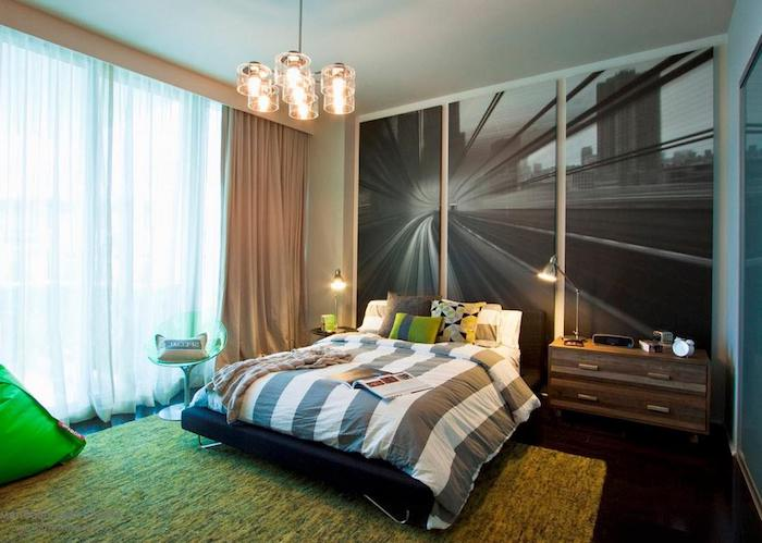 blown up black and white photograph, on three large canvases, large wall art, near double bed, with striped covers and several cushions