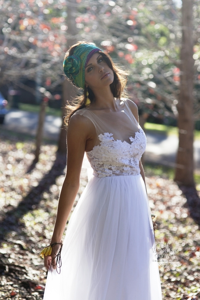 beach wedding dresses, romantic white gown, with semi-sheer embroidered top, and floaty tulle skirt, on young brunette woman, wearing a green boho head scarf
