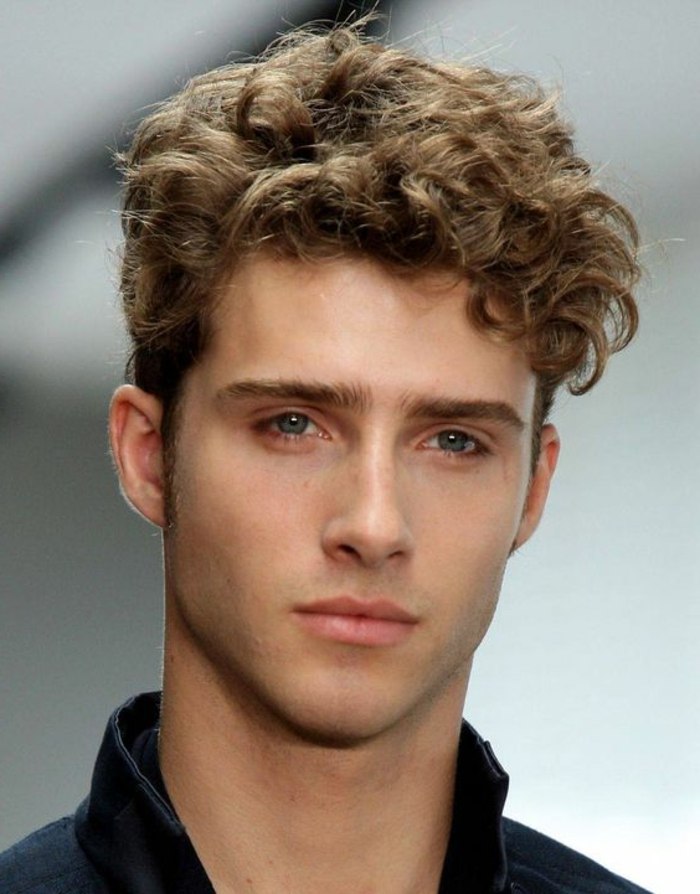 dark blonde hair, long on top, and shorter on the sides, worn by slim young man, with blue eyes, hairstyles for curly hair