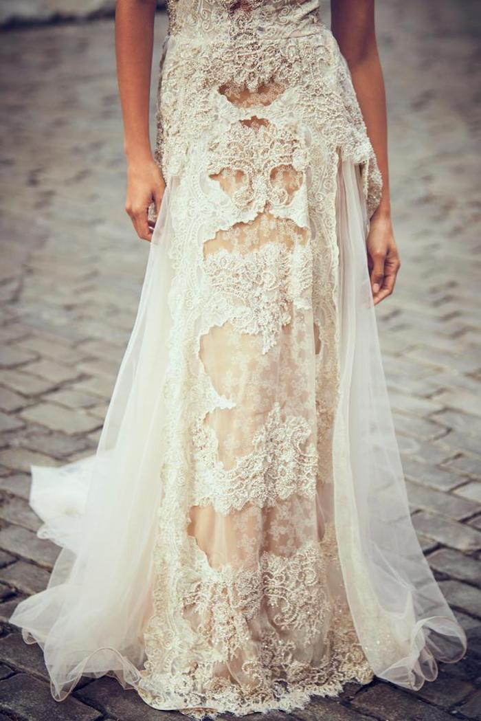 skirt in ivory and cream, floaty and heavily embroidered, part of a lace beach wedding dress, worn by slim female model