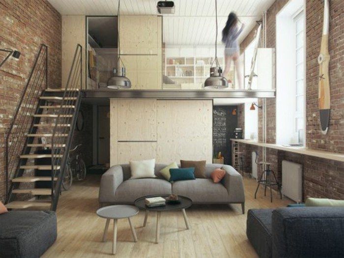 how to decorate a studio apartment, small industrial style home, on two levels, with metal staircase, modern pale gray sofa, and two round coffee tables