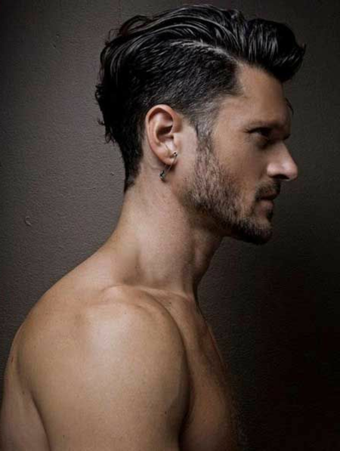 topless brunette man in profile, haircuts for curly hair, undercut with deep side part, and bangs slicked to one side