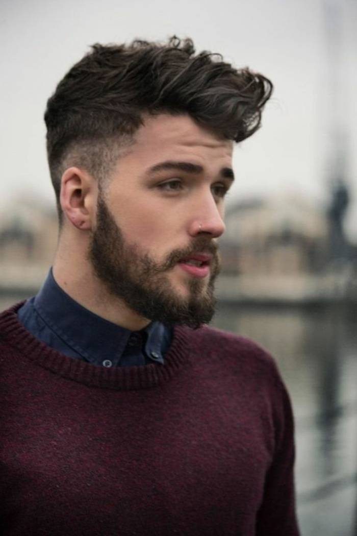 bearded man with purple knitted jumper, and dark denim shirt, hairstyles for curly hair, brunette undercut ideas