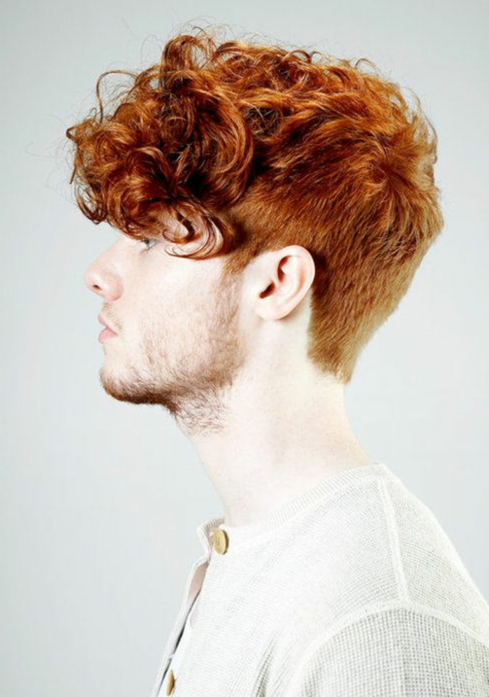 ginger haired youth, with short beard and mustache, wearing a curly quiff, with short sides and back, and long messy bangs