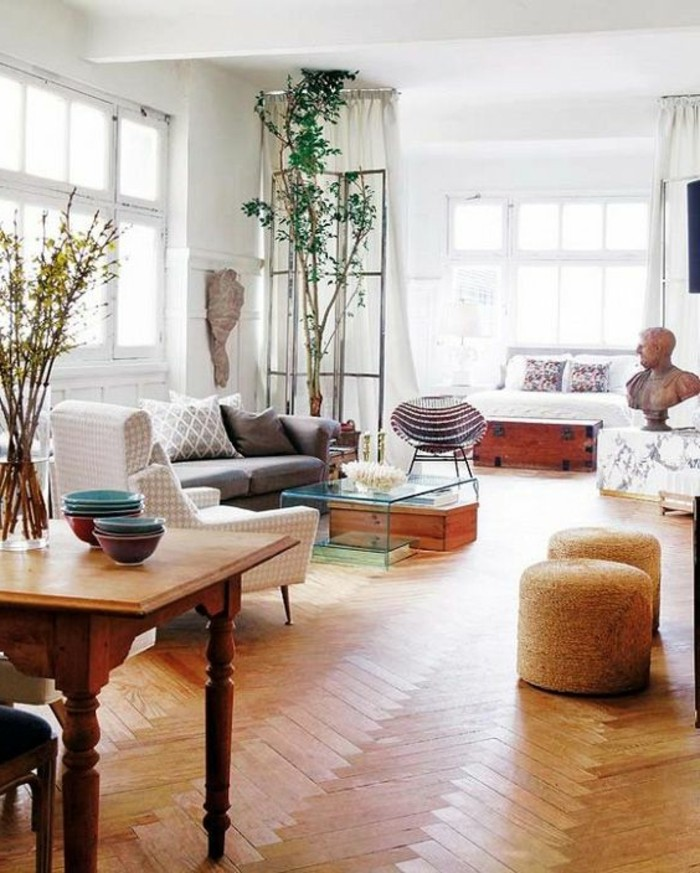 sculptures and plants, inside a spacious bright room, with retro laminate floor, and vintage furniture, studio apartment design