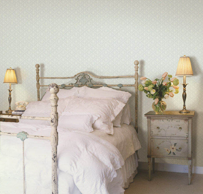 rustic decor in room with pale blue wallpaper, bedroom decorating ideas, shabby chic bed, matching bedside table, decorated with hand-drawn details
