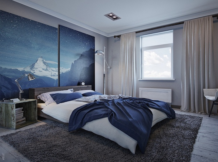 blue and white mountains, and a dark starry sky, painted on two large canvases, mounted on a bedroom wall, wall art décor