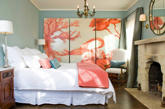 coral pink and white artwork, painted on three large canvases, wall art décor, inside bedroom with pale blue walls, and stone fireplace