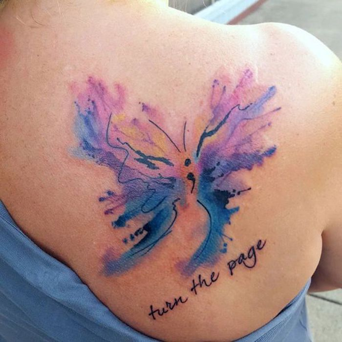 turn the page, tattooed in a black font, near a stylized butterfly, with a semicolon body, and watercolor effect wings, semicolon movement, blue and purple, yellow and black
