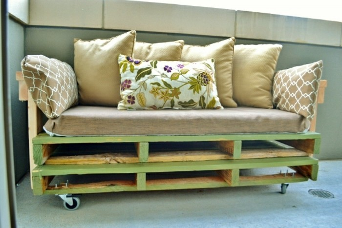 furniture made from pallets, light green wooden couch, covered with a large, beige couch cushion, and decorated with several smaller cushions