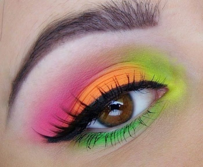 makeup looks, brown eye with black eyeliner, and neon eyeshadow, in pink and orange, green and yellow, seen in extreme closeup