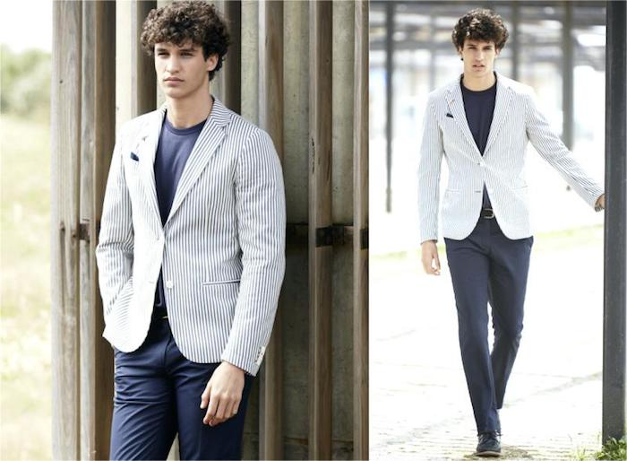 navy and white striped blazer, worn over dark blue t-shirt, and matching trousers, casual dress code, on young curly brunette man