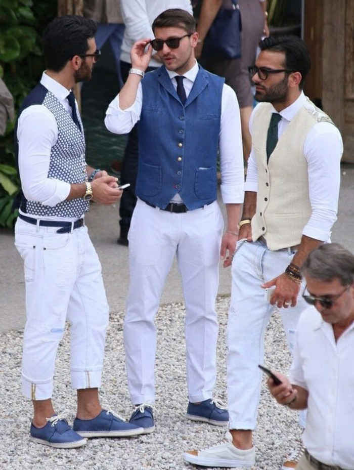 vests in different colors, white trousers and deck shoes in blue, mens casual summer wedding attire, worn by three young men, with glasses and ties