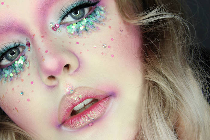 close up of a girl's face, makeup looks, sparkly pink lips, blue eye shadow, with chunky iridescent turquoise glitter, purple contouring and fake lashes
