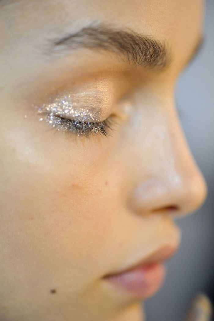 young woman's face, with no make up, except for a little bit of glitter, in the corner of her eye, makeup looks, discrete and natural style