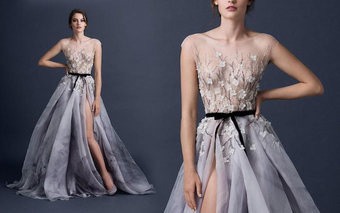 blossoms in white and grey, embroidered on the top of a floaty grey dress, with black ribbon belt and side slit