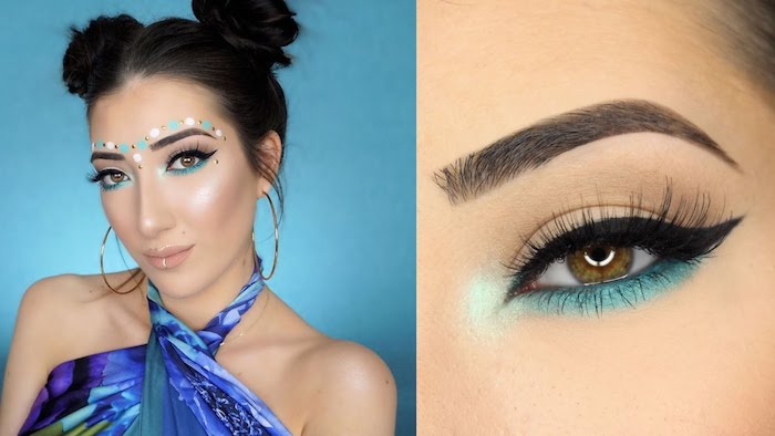 large golden hoop earnings, worn by brunette young woman, her hair shaped in two buns, she's wearing nude beige lipstick, fake lashes and black eyeliner, turquoise eyeshadow and face paint