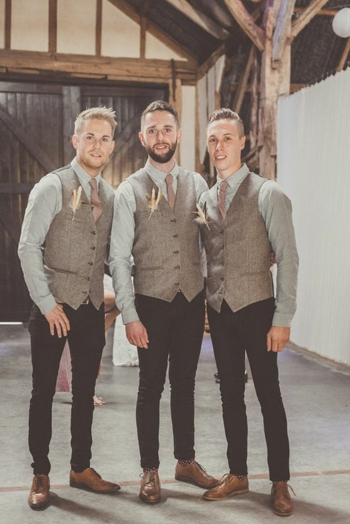 tweed formal vests in beige, worn by three men, standing next to each other, pale blue shirts, black trousers and brown shoes, boutonnieres and light ties, black tie optional wedding