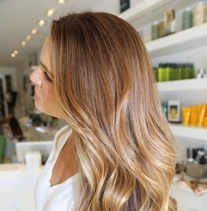 balayage brown hair, woman with light brunette, soft and wavy tresses, with honey blonde balayage, wearing white t-shirt